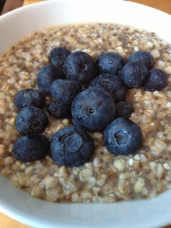 Steel-cut oats with chia seeds, blueberries, cinnamon, and maple syrup